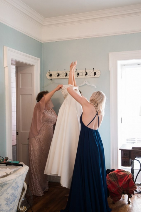 Bride putting wedding gown on photography