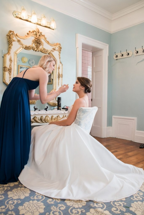 Bride getting makeup at classic spring wedding