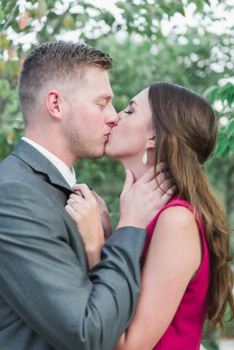 couple kissing during their engagement photos